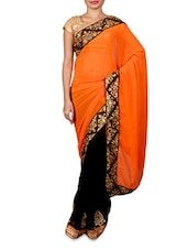 Black And Orange Georgette Embroidered Sari - By