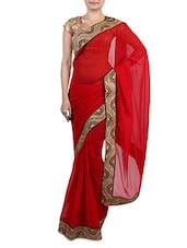 Red Faux Georgette Saree With Gold Border - By