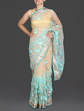 Beige And Sky Blue Floral Net Saree - By