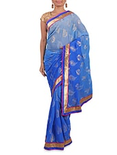 Blue Printed Crepe Saree With Gold Border - By