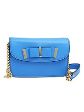 Blue Leatherette Bow Sling Bag - By