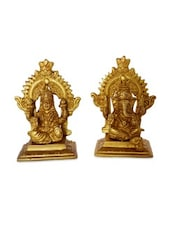 Yellow Brass Laksmi And Ganesha Sitting On A Carving Throne - By