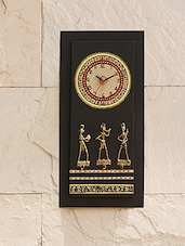 An Ethnic Style Wooden Wall Clock With Brass Work - By