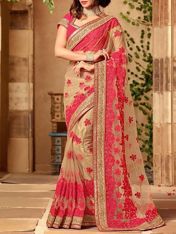Buy Pink Net Embroidered Saree With Blouse By Tiana Creation
