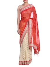 Orange And Cream Lehariya Saree With Lace Border - By