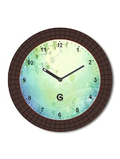 Multicolored Plastic And Glass Geometric Shapes Printed Floral Printed Wall Clock - By
