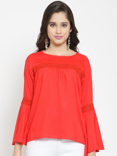 77242e94fa784 Buy Criss-cross Lace Up Flared Sleeve Top for Women from Vaanya for ...