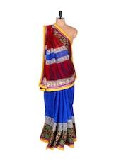 Extensively Trimmed Georgette Saree - Vishal Sarees