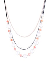 BLACK AND GOLD CHAIN WITH ROUND PEARLS AND ORANGE BEADS - THE BLING STUDIO