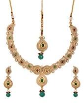 Maroon And Green Tear Drop Embellished Kundankari Necklace, Earrings And Maang Tikka - SriyasCreation