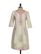 Beige Ethnic Print Cotton Kurta With A Fuchsia Pink Embroidered Placket And Bottom - STRI