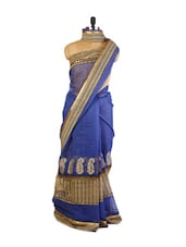 Bold Blue Super Net Saree With Zari Embroidery, Resham Embroidered Border, Patch Border And A Matching Beige Blouse. - Drape Ethnic