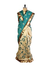Graceful Green And Beige Art Silk Saree With Resham Embroidery, Zari Embroidery, Patch Border And A Matching Beige Blouse. - Drape Ethnic