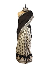 Graceful Cream And Black  Art Silk Saree  Screen Print Work, Zari Embroidered And Patch Border, Silver Blouse. - Drape Ethnic