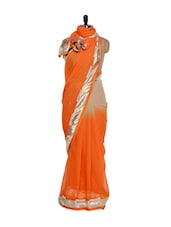 Orange Georgette Saree With Pearl And Stone Work On The Border - Purple Oyster
