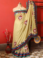 Elegant Beige Saree With Red And Green Embroidered Border, With Matching Blouse Piece - Urvashi's