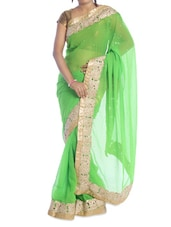 Light Green Saree With Gold Border - Suchi Fashion