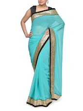 Elegant Blue Georgette Saree With Sequins Border - Aakriti