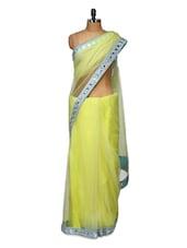 Elegant Yellow Net Saree - Purple Oyster