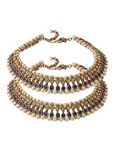 Pair Of Gold Plated Anklets Adorned With Shiny CZ, Blue Color Stones And Pearls - Voylla