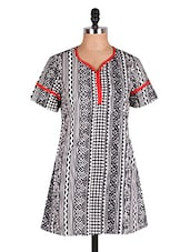Red Piping Detailed Printed Cotton Kurti - Cotton Curio